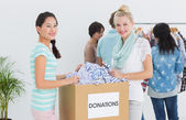 People with clothes donation — Stock Photo