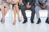 Low section of people waiting for job interview in office — Stock Photo