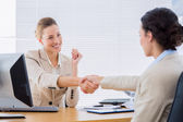 Women shaking hands in a business meeting — Stock Photo