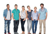 Portrait of casual happy people with hands in pockets — Stock Photo