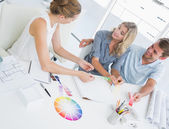 Group of artists working on designs — Stock Photo