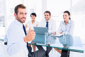 Executive gesturing thumbs up with recruiters during interview — Stock Photo