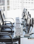 Chairs, computers and headset in modern office — Stock Photo