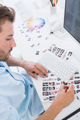Male photo editor at work in the office — Stock Photo