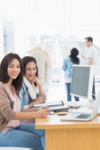 Female artists working at desk in creative office — Stock Photo