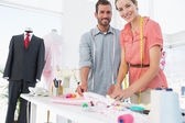 Fashion designers at work in bright studio — Stock Photo