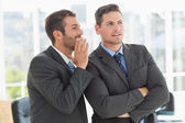 Young well dressed businessmen in discussion — Stock Photo