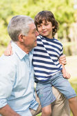 Grandfather and son smiling in the park — Stock Photo