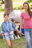 Mother and daughter with family behind in park — Stock Photo