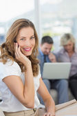 Businesswoman on call with colleagues using laptop — Stockfoto