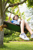 Low angle view of a cute little boy on swing — Stock Photo