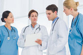 Doctors looking at report in hospital — Stock Photo