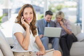 Businesswoman on call with colleagues using laptop — Stock Photo