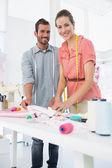 Fashion designers at work in bright studio — Stock Photo
