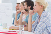 Artists in row during meeting at office — Stock Photo