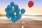 Balloons above a road — Stock Photo