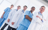 Portrait of doctors standing in a row at hospital — Stock Photo