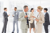 Business people chatting at a conference — Stock Photo
