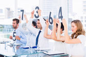 Froup of panel judges holding score signs — Foto Stock