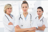 Three confident female doctors with arms crossed — Stock Photo