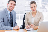 Smartly dressed colleagues in business meeting — Stock Photo