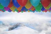 Many colourful balloons above snow — Stok fotoğraf