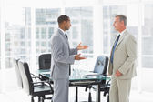 Businessmen speaking in the conference room — Stock Photo