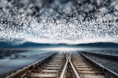 Train tracks under blanket of bright stars — Stock Photo