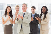Business team standing and clapping — Stock Photo