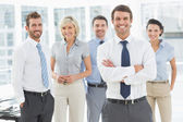 Confident business team together in office — Foto Stock