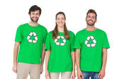 Young people wearing recycling symbol t-shirts — Stock Photo