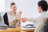 Smartly dressed women shaking hands in business meeting — Stock Photo