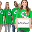 Stock Photo: People in recycling symbol t-shirts with donation box