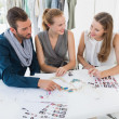 Stock Photo: Three fashion designers discussing designs