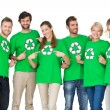 Stock Photo: People in recycling symbol t-shirts pointing to themselves