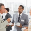 Business people talking and having coffee at conference — Stock Photo #39190475
