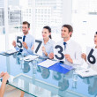 Group of panel judges holding score signs in front of woman — Stock Photo #39190759