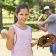 Father and daughter playing baseball — Stock Photo #39190795