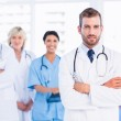 Confident happy group of doctors at medical office — Stock Photo #39190875