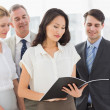 Businesswoman reading a document with her team — Stock Photo
