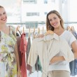 Young women shopping in clothes store — Stock Photo #39190931