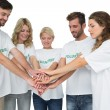 Stock Photo: Group of young volunteers with hands together