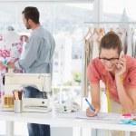 Fashion designers at work in bright studio — Stock Photo #39191409