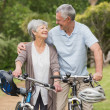 Stock Photo: Senior couple on cycle ride at the park