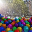 Stock Photo: Many colourful balloons in street