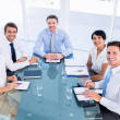 Stock Photo: Executives sitting around conference table