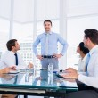 Executives sitting around conference table — Stock Photo #39193553