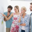Artists in discussion in front of whiteboard — Stock Photo #39193655