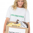 Smiling young woman carrying clothes donation — Stock Photo