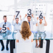 Group of panel judges holding score signs in front of woman — Stock Photo
